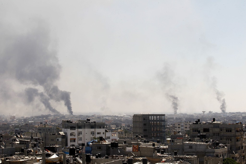 . Smoke billows from buildings following an Israeli military strike east of Rafah in the southern Gaza Strip, on August 1, 2014. Israeli shelling killed eight people in southern Gaza, medics said, just hours after a 72-hour humanitarian ceasefire took effect. AFP PHOTO/ SAID KHATIB/AFP/Getty Images