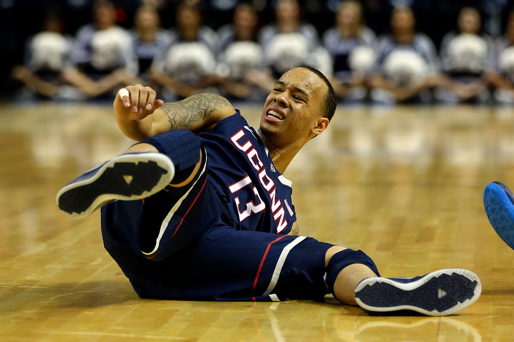 . BUFFALO, NY - MARCH 22: Shabazz Napier #13 of the Connecticut Huskies falls down against the Villanova Wildcats during the third round of the 2014 NCAA Men\'s Basketball Tournament at the First Niagara Center on March 22, 2014 in Buffalo, New York.  (Photo by Elsa/Getty Images)
