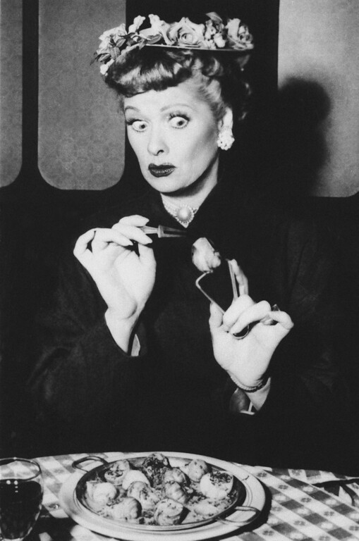 ". Lucille Ball as Lucy Ricardo tries escargot in Paris in a scene from TV\'s ""I Love Lucy,\"" March 1956. (AP Photo) No Sales"