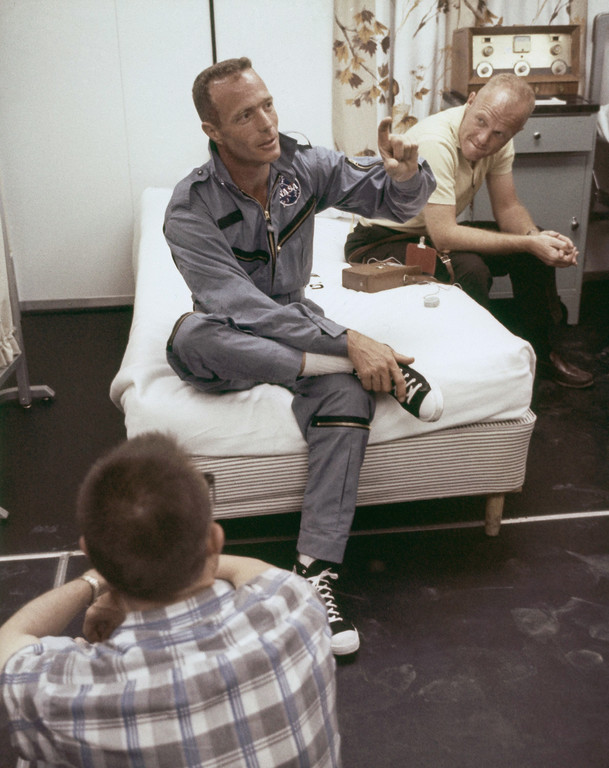. Astronaut Scott M. Carpenter seated on bed, with astronaut John Glenn in May 1962. (AP Photo)