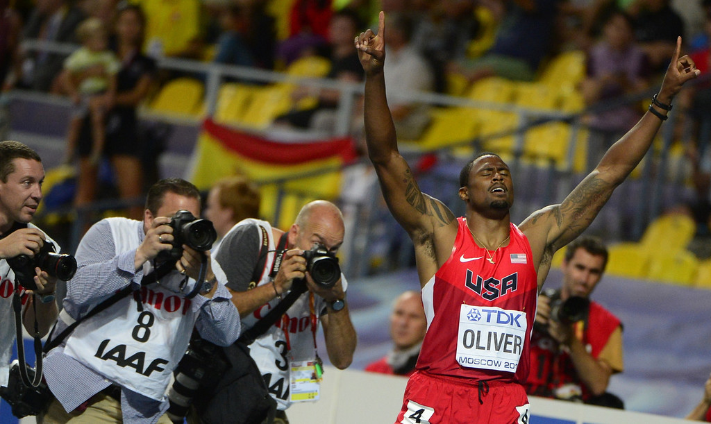 . US\'s David Oliver celebrates after winning the men\'s 110 meters hurdles final at the 2013 IAAF World Championships at the Luzhniki stadium in Moscow on August 12, 2013. AFP PHOTO / OLIVIER  MORIN/AFP/Getty Images