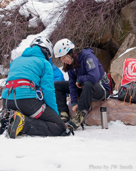 Ouray 2012-11 - Day two. Leah gets help with ill-fitting boots from Danica, of San Juan Mountain Guides.