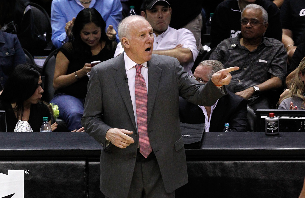 . Head coach Gregg Popovich of the San Antonio Spurs calls out in the second half while taking on the Oklahoma City Thunder in Game One of the Western Conference Finals during the 2014 NBA Playoffs at AT&T Center on May 19, 2014 in San Antonio, Texas.  (Photo by Chris Covatta/Getty Images)