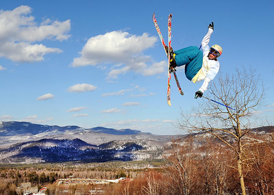 Blake Williams of Newry catches some air off a jump at Sunday River.  Even though the grass is green in many towns in Maine, the ski areas still have ideal skiing conditions thanks to last week's storm that dumped several feet of snow at most of the major resorts in the state.