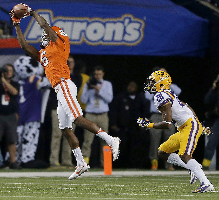 . Clemson wide receiver DeAndre Hopkins (6) makes a catch against LSU cornerback Jalen Mills (28) watches during the first half of the Chick-fil-A Bowl NCAA college football game, Monday, Dec. 31, 2012, in Atlanta. (AP Photo/David Goldman)