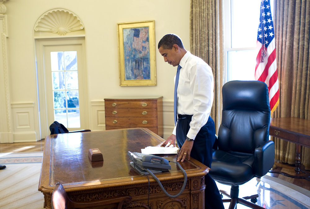 "Description of . Jan. 21, 2009 ""This was his first morning in the Oval Office as President of the United States. He was reading some briefing material before a meeting."" (Official White House photo by Pete Souza)"
