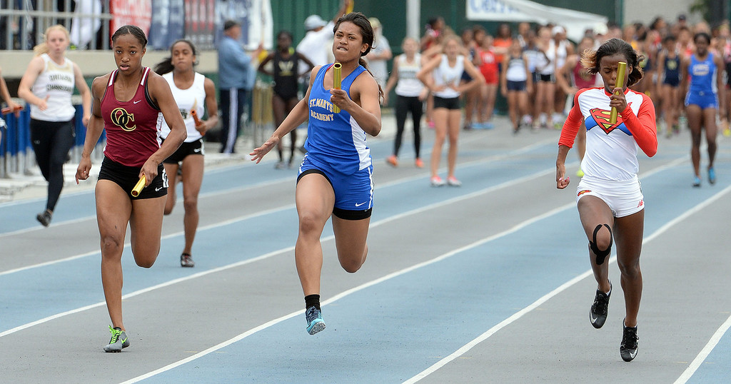 . St. Mary\'s Academy\'s Sierra Peterson, center, runs the final leg along with Serra\'s Kayla Pickens, right, and Oaks Christian\'s Miah Webb, left, 4x100 meter relay Division 4 as St. Mary\'s Academy wins the race during the CIF Southern Section track and final Championships at Cerritos College in Norwalk, Calif., Saturday, May 24, 2014.   (Keith Birmingham/Pasadena Star-News)