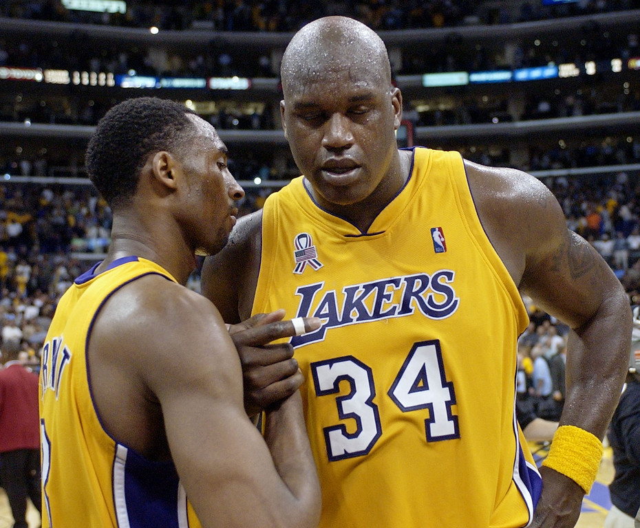 . Los Angeles Lakers\' Shaquille O\'Neal (34) shakes hands with teammate Kobe Bryant, left, after they defeated the San Antonio Spurs 93-87 in Game 5 of the Western Conference semifinals Tuesday, May 14, 2002, in Los Angeles. The Lakers advance to the conference finals against the Sacramento Kings.  (AP Photo/Mark J. Terrill)