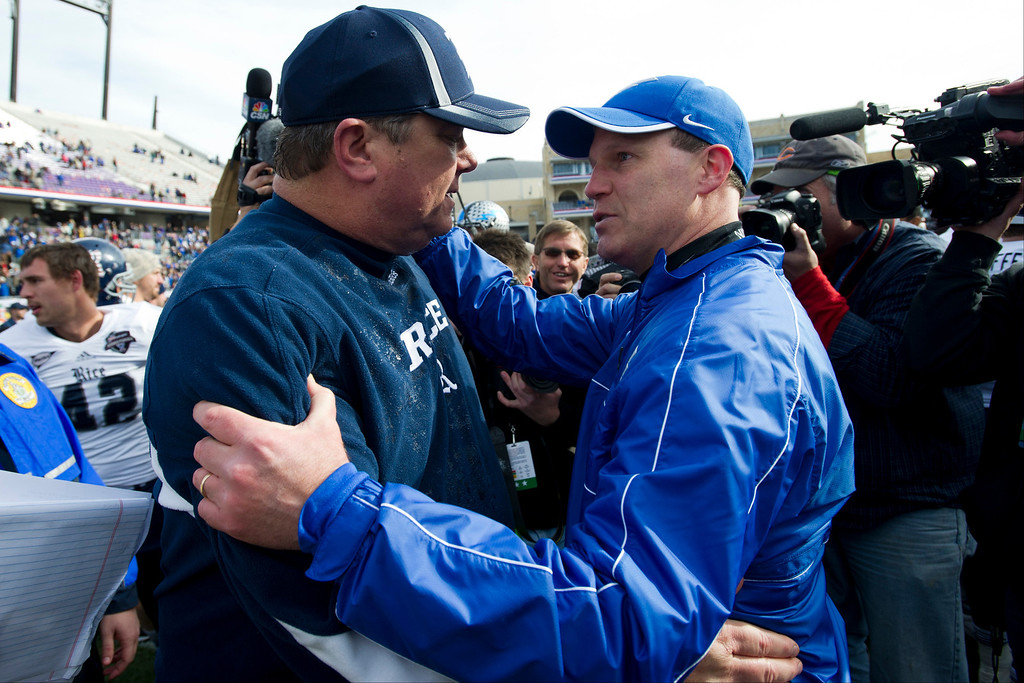 . Head Coach David Bailiff of the Rice Owls (left) and Head coach Troy Calhoun of the Air Force Falcons exchange words after the Bell Helicopter Armed Forces Bowl on December 29, 2012 at Amon G. Carter Stadium in Fort Worth, Texas.  (Photo by Cooper Neill/Getty Images)