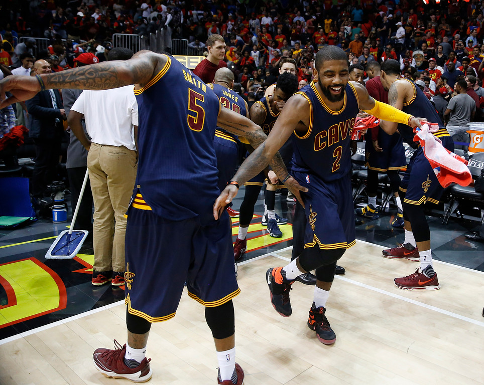 . Cleveland Cavaliers\' J.R. Smith (5) and Kyrie Irving (2) celebrate after Game 3 of the second-round NBA basketball playoff series against the Atlanta Hawks, Friday, May 6, 2016, in Atlanta. Cleveland won 121-108 and leads the best-of-seven series 3-0. (AP Photo/John Bazemore)