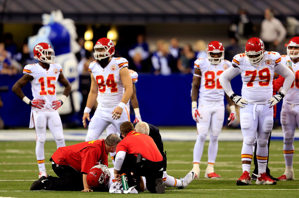 . INDIANAPOLIS, IN - JANUARY 04:  Running back Knile Davis #34 of the Kansas City Chiefs receives medical attention during a Wild Card Playoff game against the Indianapolis Colts at Lucas Oil Stadium on January 4, 2014 in Indianapolis, Indiana.  (Photo by Rob Carr/Getty Images)