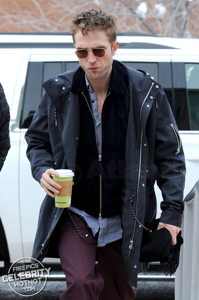 Robert Pattinson Stylish in Black & Orange Adidas Sneakers Carrying Green Cup in Utah