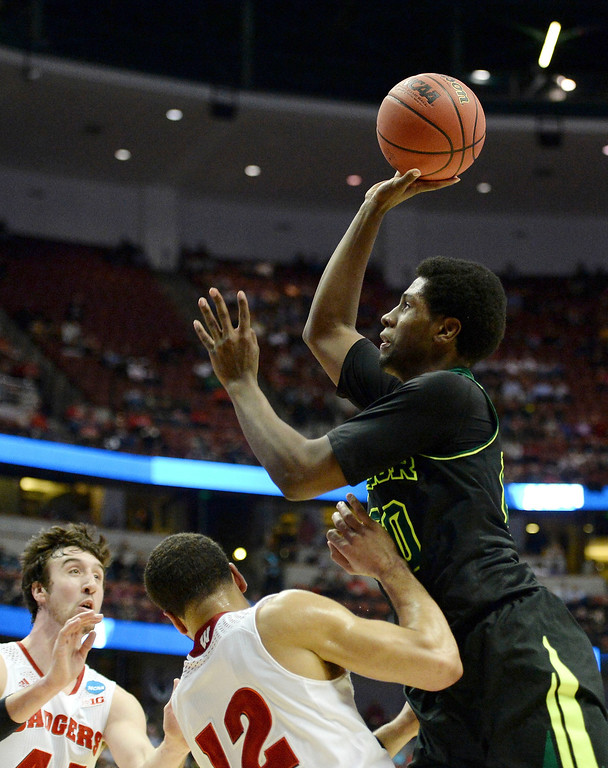 . Royce O\'Neale #00 of the Baylor Bears shoots over Traevon Jackson #12 of the Wisconsin Badgers in the first half during the regional semifinal of the 2014 NCAA Men\'s Basketball Tournament at the Honda Center on March 27, 2014 in Anaheim, California.  (Photo by Harry How/Getty Images)