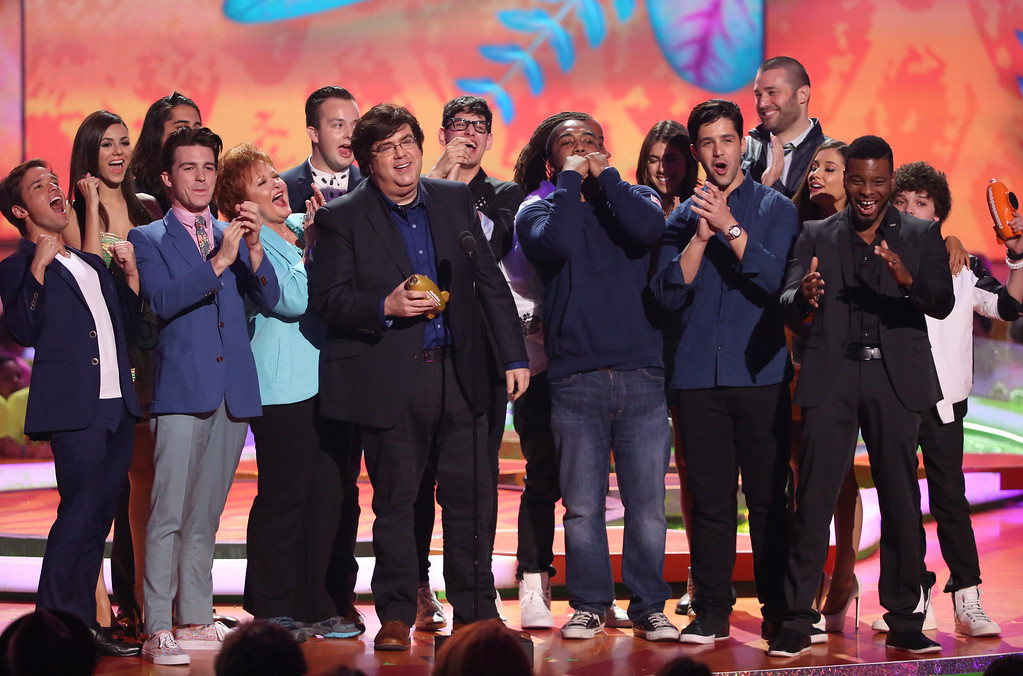 . Dan Schneider accepts the lifetime achievement award. The award was presented by Nickelodeon cast members at the 27th annual Kids\' Choice Awards at the Galen Center on Saturday, March 29, 2014, in Los Angeles. (Photo by Matt Sayles/Invision/AP)