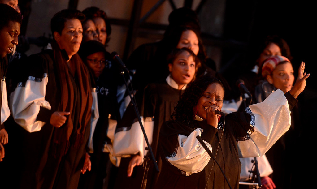 . Tyesha Sherry leads the Ecclesia Christian Fellowhip gospel choir in dong during Easter Sunrise services at the Roosevelt Bowl in San Bernardino March 31, 2013.  Over 600 local Christians gathered to celebrate the resurrection of Jesus Christ.  GABRIEL LUIS ACOSTA/STAFF PHOTOGRAPHER.