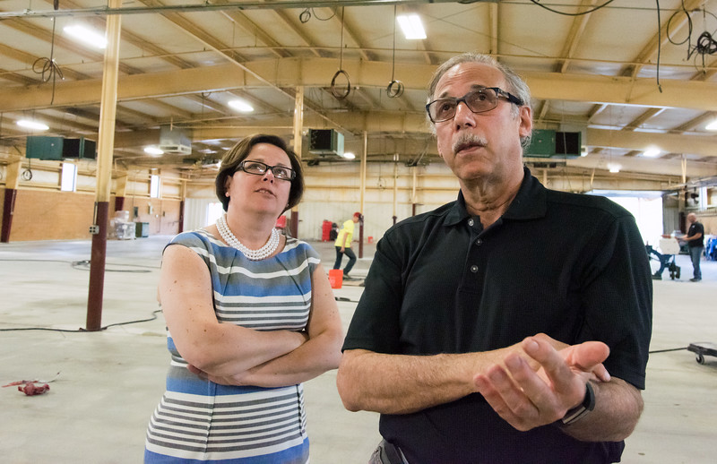 06/25/18  Wesley Bunnell | Staff  Bristol Mayor Ellen Zoppo-Sassu stands with owner Ron Weintraub from Curtis Products as he points out the renovation of their new Bristol location on Monday afternoon. The Bristol Development Authority has awarded grants to help businesses expand and relocate to town.