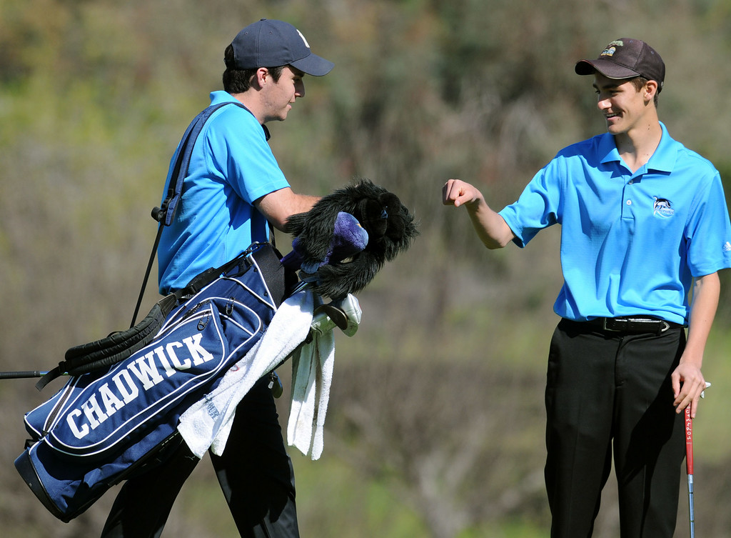 . Chadwick\'s Greg Stone, left, and Ethan Leff, right, fist bump on the second hole against Peninsula in a round of golf Tuesday at the Palos Verdes Golf Club.