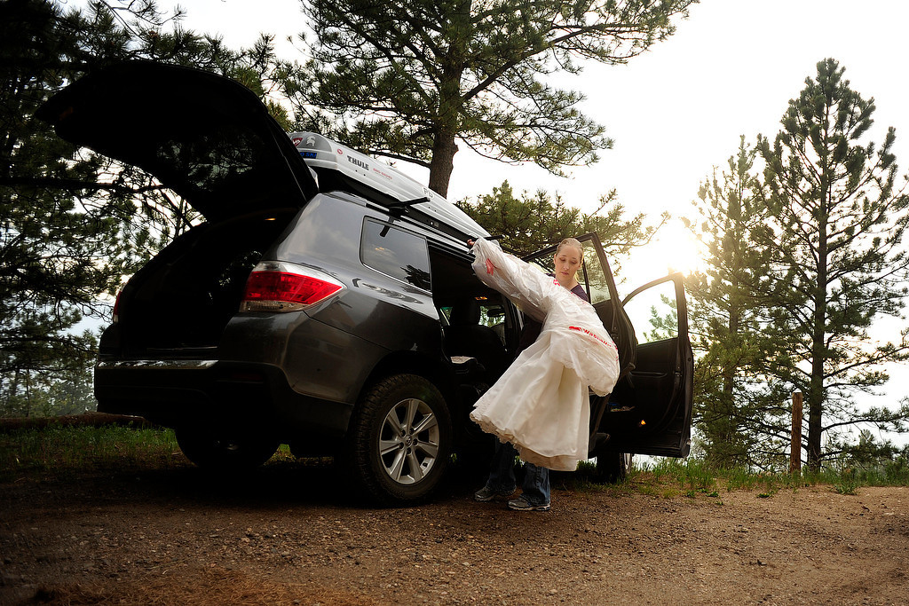 . Rebecca DeMott packs her wedding dress as her parents\' home in Glacier View Meadows was under pre-evacuation notice as the High Park fire burns on Stove Prairie Road and Highway 14 in Poudre Canyon west of Fort Collins on Tuesday, June 12, 2012. The fire has now burned more than 40,000 acres encompassing more than 65 square miles. AAron Ontiveroz, The Denver Post