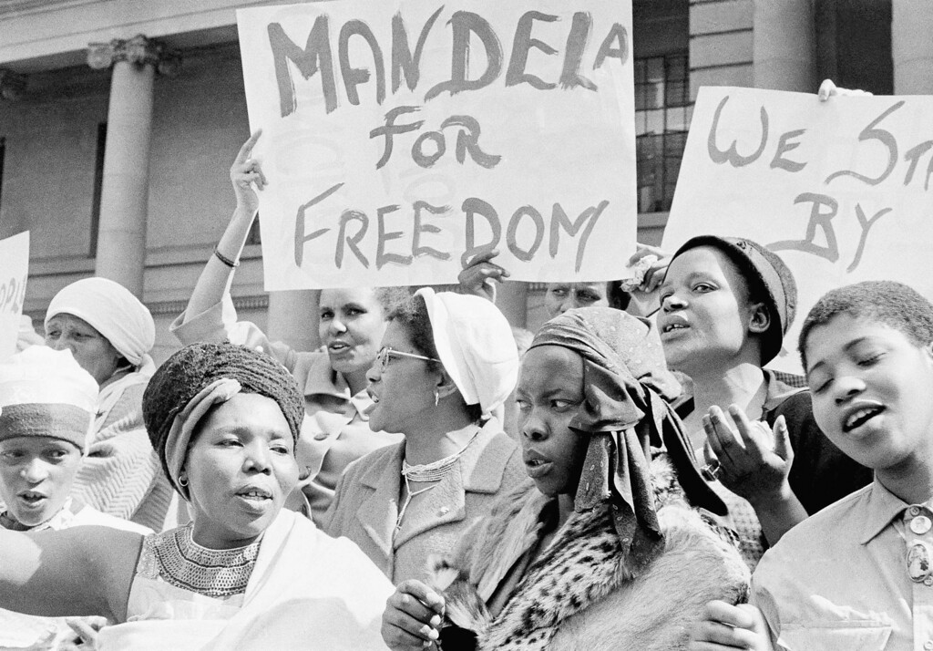 ". African women join in a demonstration in South Africa, Aug. 16, 1962, demanding the release of Nelson Mandela, former secretary of the banned African National Congress, who appeared in court on a charge of incitement.  The women, together with Winnie Mandela chanted ""down with Verwoerd on the steps of the Johannesburg City Hall. (AP Photo/Dennis Lee Royle)"