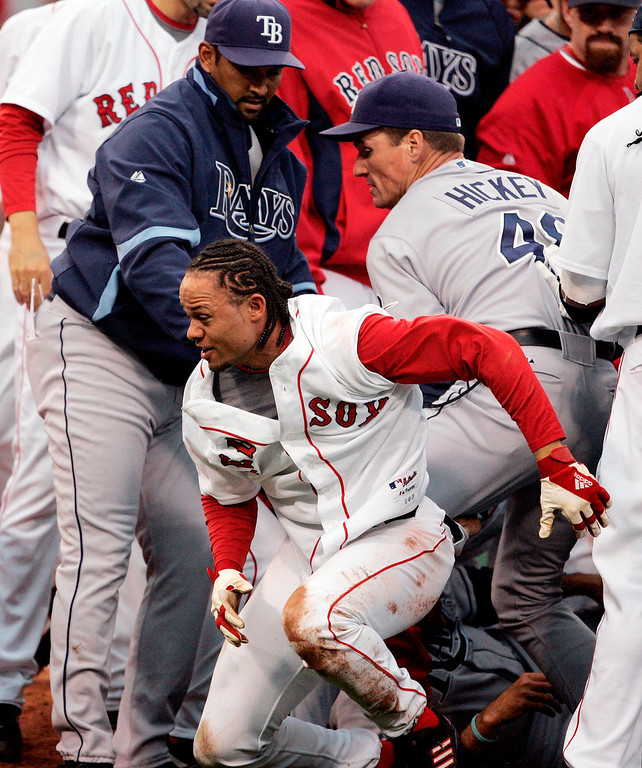 . Boston Red Sox\'s Coco Crisp, center, scrambles out from the center of a brawl behind Tampa Bay Rays coach Jim Hickey, right, in the second inning of a baseball game, Thursday, June 5, 2008, in Boston.  Crisp charged the mound after being hit by a pitch thrown by the Rays\' James Shields which resulted in the bench-clearing brawl. (AP Photo/Michael Dwyer)