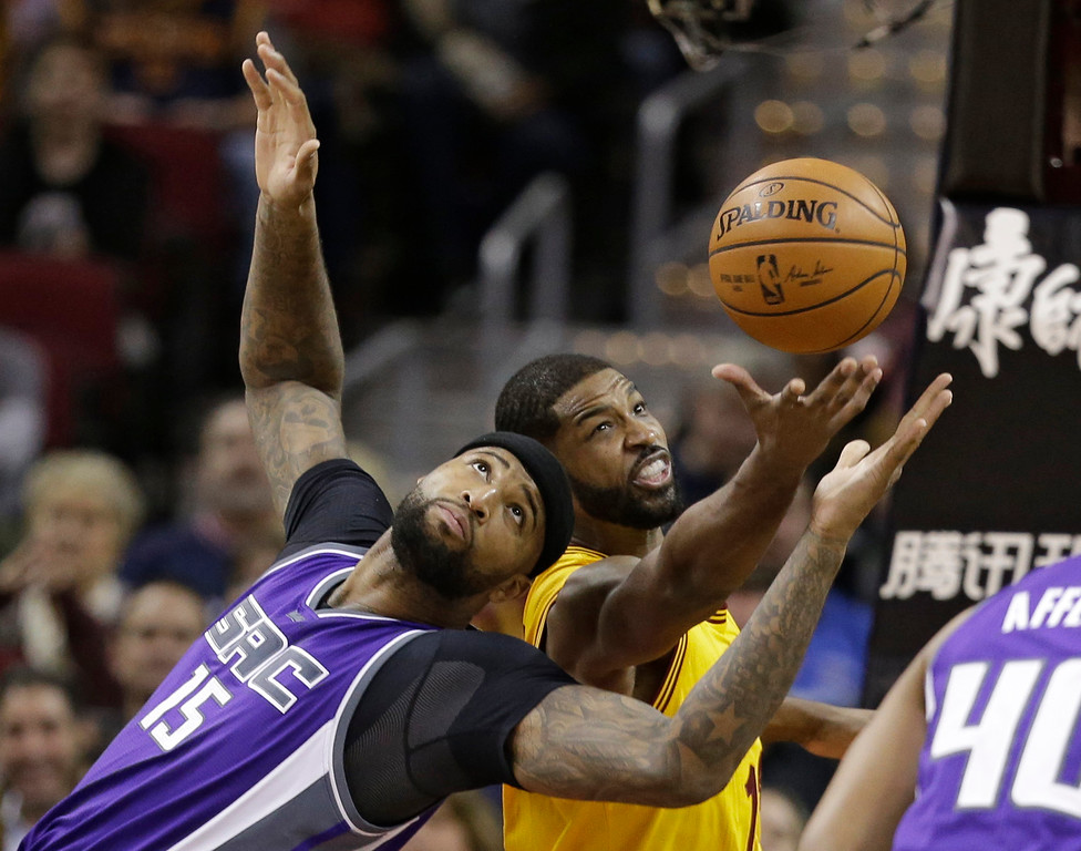. Sacramento Kings\' DeMarcus Cousins (15) and Cleveland Cavaliers\' Tristan Thompson (13) battle for a loose ball during the first half of an NBA basketball game, Wednesday, Jan. 25, 2017, in Cleveland. (AP Photo/Tony Dejak)
