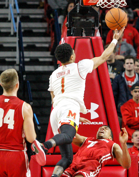 January 20, 2018: Maryland guard Anthony Cowan (1) goes for a layup over Wisconsin guard D'Mitrik Trice (0) during BIG Ten Men Basketball action between University of Wisconsin and University of Maryland in College Park. Photo by: Chris Thompkins/Prince Georges Sentinel