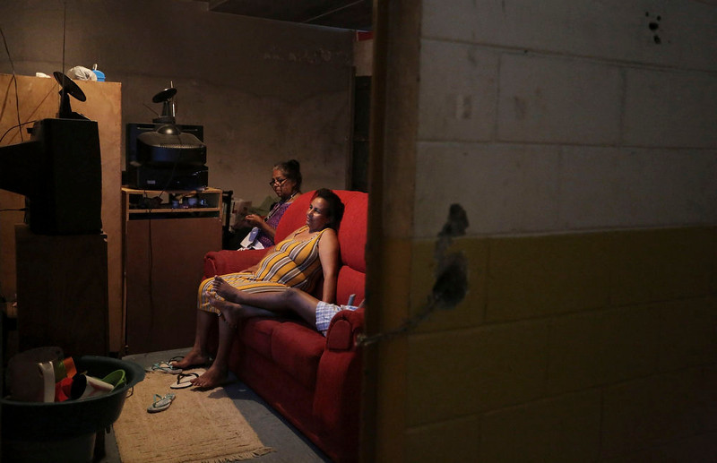 . Members of Brazil\'s Movimento dos Sem-Teto (Roofless Movement) watch TV at an area that used to be a nursery and school in Sao Paulo March 10, 2013. More than 1,200 people from Brazil\'s roofless movement live in an explosion prone area that has been contaminated with methane since October 2012, local media reported. According to the Environmental Sanitation Technology Company in the State of Sao Paulo (CETESB) the soil and water from the groundwater are contaminated with methane. Picture taken March 10, 2013. REUTERS/Nacho Doce