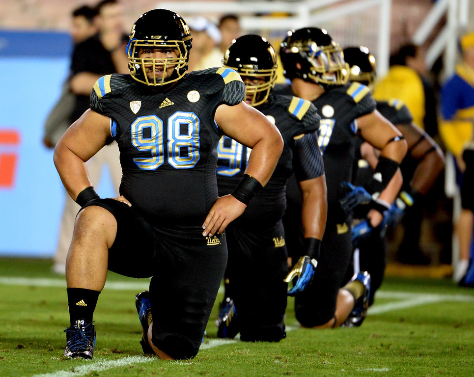 . UCLA Bruins wearing black uniforms with gold trim prior to their college football game against the Washington Huskies in the Rose Bowl in Pasadena, Calif., on Friday, Nov. 15, 2013.   (Keith Birmingham Pasadena Star-News)