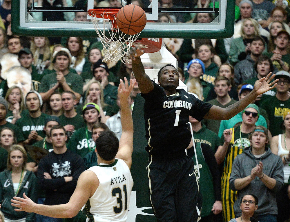. Colorado\'s Wesley Gordon rejects the shot of J.J. Avila during an NCAA game against CSU on Tuesday, Dec. 3, 2013, at the Moby Arena in Fort Collins. Jeremy Papasso/ Camera