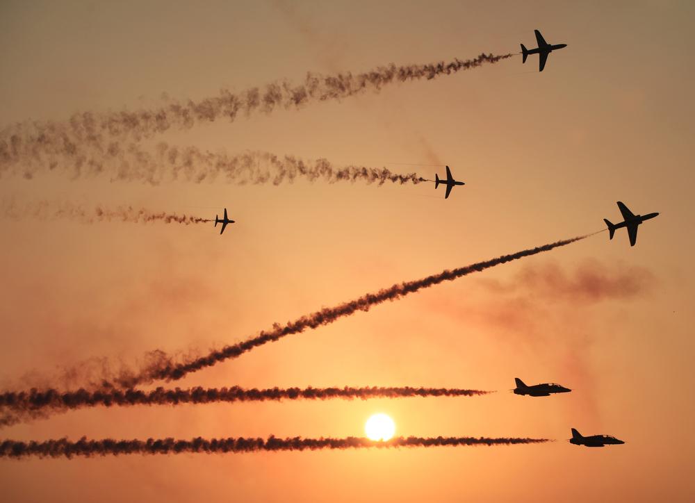. The Saudi Hawks Display Team performs Thursday, Jan. 16, 2014, at the Bahrain International Airshow in Sakhir, Bahrain. Bahrain\'s state news agency says the International Airshow opened to announcements of more than $3 billion in agreements. (AP Photo/Hasan Jamali)