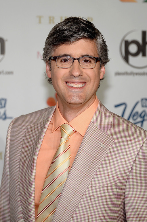 . Writer, comedian and pageant judge Mo Rocca arrives at the 2013 Miss USA pageant at Planet Hollywood Resort & Casino on June 16, 2013 in Las Vegas, Nevada.  (Photo by Ethan Miller/Getty Images)