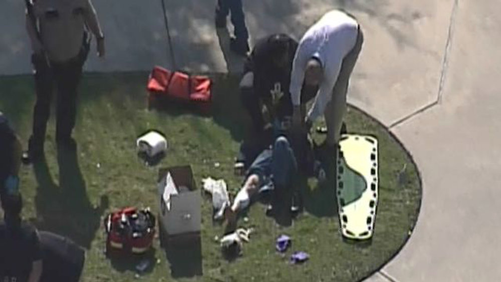 . Police and emergency crews attend to injured outside a building on the Lone Star College Campus near Houston, Texas in this still image taken from video courtesy of KPRC-TV Houston January 22, 2013.  Multiple people have been shot according to news reports.  REUTERS/KPRC-TV Houston/Handout