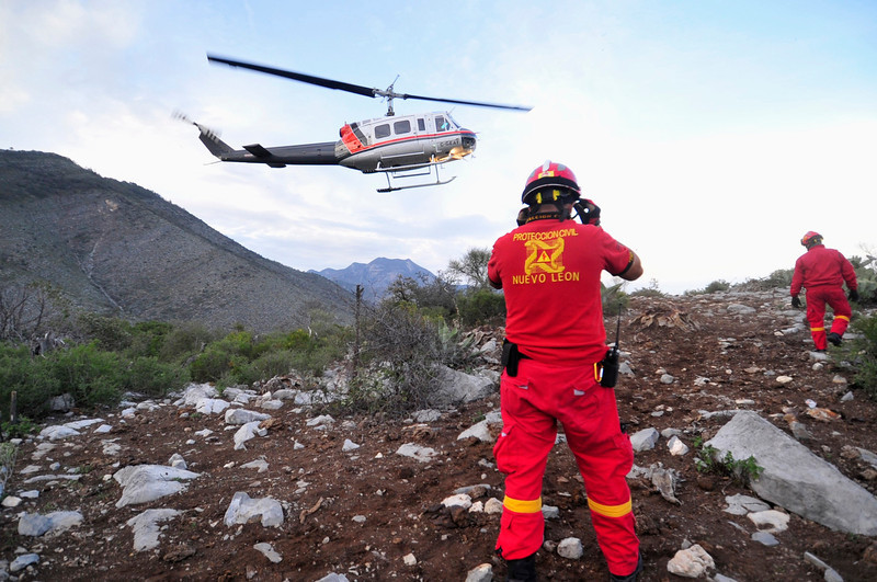 . Civil Protection personnel inspect the perimeter of the crash site of a plane with Mexican-American singer Jenni Rivera on board, in the municipality of Iturbide, south of Monterrey December 9, 2012. Rivera died in a plane crash after the small jet she was travelling in went down in northern Mexico, her father said on Sunday. Speaking after the wreckage was discovered, the singer\'s father, Pedro Rivera, told Telemundo television all seven of the people on board the plane, including two pilots, had died. REUTERS/Stringer
