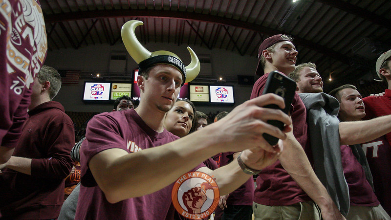 A student takes a selfie on the floor of Cassell after the game. Virginia Tech defated Virginia 80-78 in 2OT. (Mark Umansky/TheKeyPlay.com)