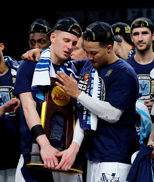 . Villanova\'s Donte DiVincenzo, left, and Jalen Brunson celebrates with the championship trophy after the championship game of the Final Four NCAA college basketball tournament against Michigan, Monday, April 2, 2018, in San Antonio. Villanova won 79-62. (AP Photo/David J. Phillip)