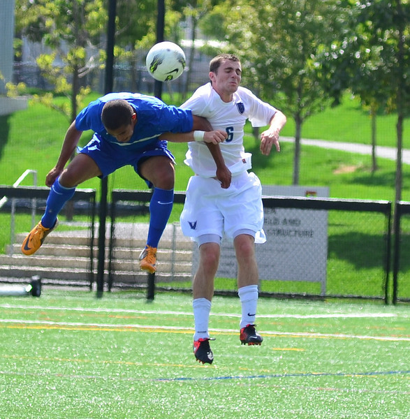 Alex Frazier beats Villanova's Sean Sheridan to the ball.