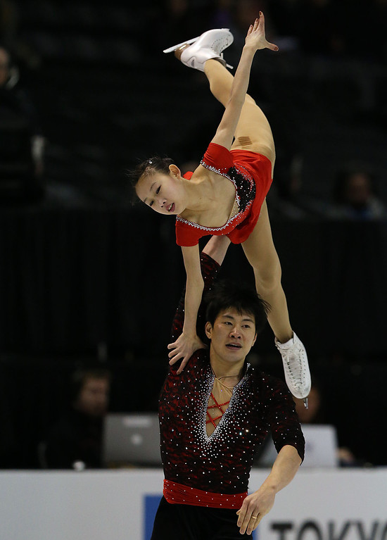 . Cheng Peng and Hao Zhang of China skate in the Pairs Free Skating Program during the 2013 ISU World Figure Skating Championships at Budweiser Gardens on March 15, 2013 in London, Ontario, Canada. (Photo by Dave Sandford/Getty Images)