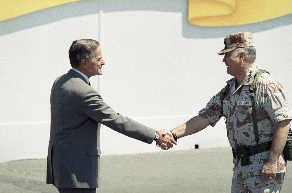 Description of . President Bush shakes hands with Gen. Norman Schwarzkopf, commander of Operation Desert Storm, during the National Victory Parade in Washington on Saturday, June 8, 1991. Thousands turned out to view the parade. (AP Photo/Ron Edmonds)