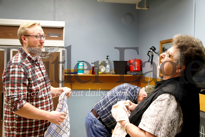 Bill Patrick of Cabot chats with St. Paul's Parish volunteer Norma O'Donnell while cleaning trays during Tuesday's church dinner. Patrick was among volunteers from Young Adult Ministry helping out for the church's weekly meal. Seb Foltz/Butler Eagle