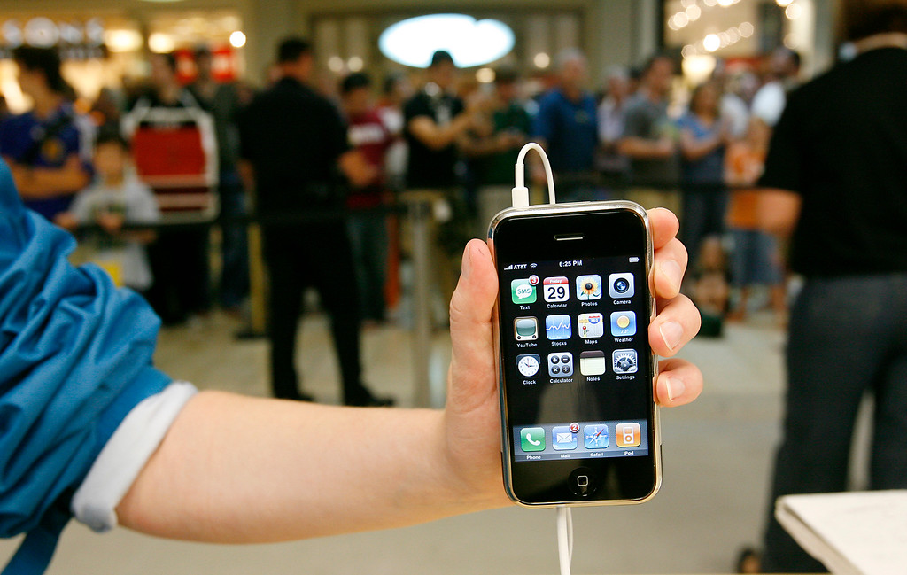 . A customer holds a demonstration Apple iPhone during the release of the Apple product and the opening of a new Apple Store at Woodland Hills Mall in Tulsa, Okla., on Friday, June 29, 2007. More than 500 people waited in line. (AP Photo/David Crenshaw)