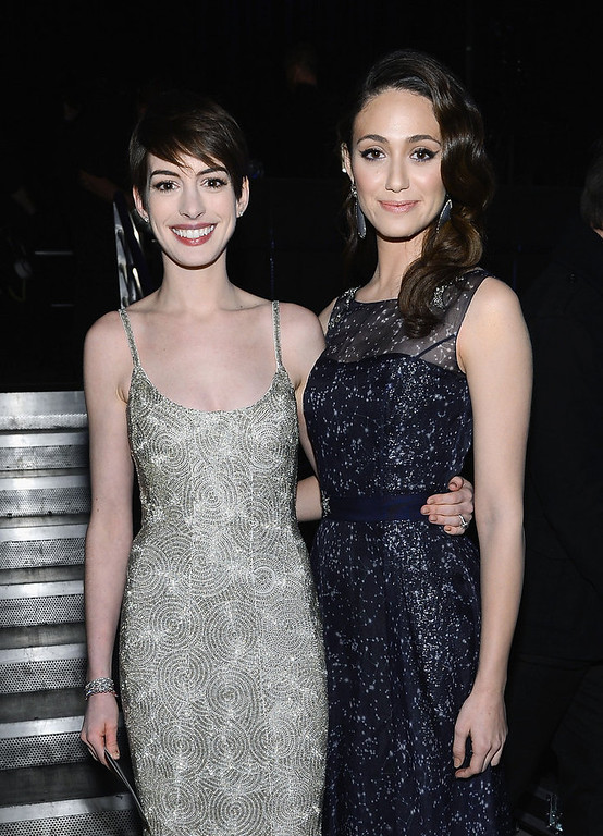 . Actresses Anne Hathaway (L) and Emmy Rossum attends the 18th Annual Critics\' Choice Movie Awards held at Barker Hangar on January 10, 2013 in Santa Monica, California.  (Photo by Larry Busacca/Getty Images for BFCA)