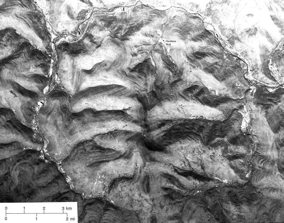 . This is a 1976 aerial of Panther Mountain ringed by the Esopus and Woodland Creeks about 20 miles northwest of Kingston, N.Y. State geologist Yngavar Ishachsen believes the unusual circular valley is the result of an asteroid impact roughly 300 million years ago. (AP Photo/NASA)