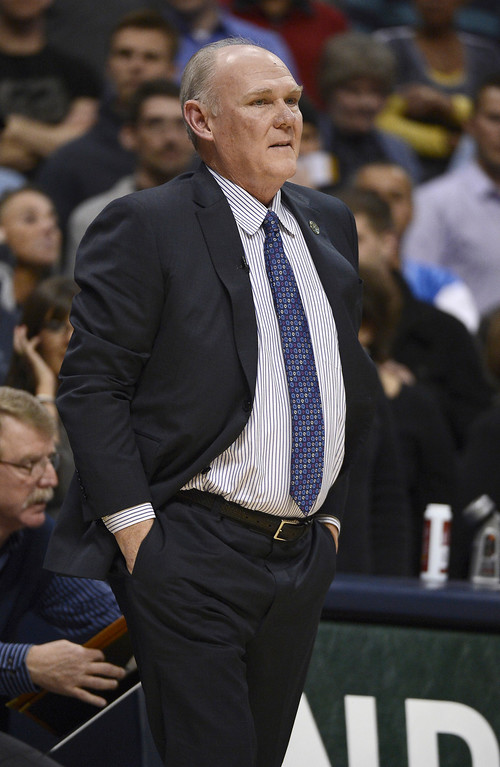 . The Denver Nuggets coach George Karl call a timeout in the first period against the San Antonio Spurs April 10, 2013 at Pepsi Center. (Photo By John Leyba/The Denver Post)
