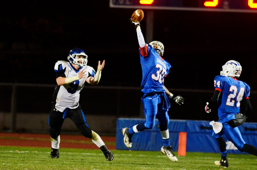 . Erica Miller - The Saratogian @togianphotog      Saratoga\'s Camarin Ellis tried to make an interception with LaSalle\'s Seamus Kelley during their playoff football game against LaSalle on Friday evening under the lights in Saratoga. SAR-l-SarFootball15