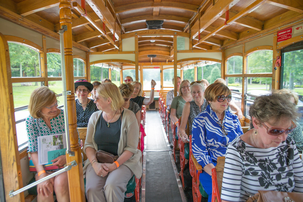 . Attendees ride Lolly the Trolley between gardens during the United Way of Lake County\'s first Solstice Garden Party. The event hosted by the Women\'s Leadership Council raised nearly $9,000 in support of women and girls in need. (courtesy Katherine Kurkov)