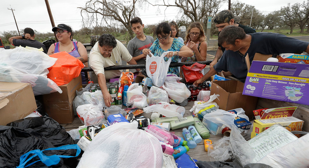 . Residents pick through needed items at a make-shift aid station, Sunday, Aug. 27, 2017, in Rockport, Texas. A group from the Texas Rio Grande Valley created station for those in need following Hurricane Harvey. (AP Photo/Eric Gay)