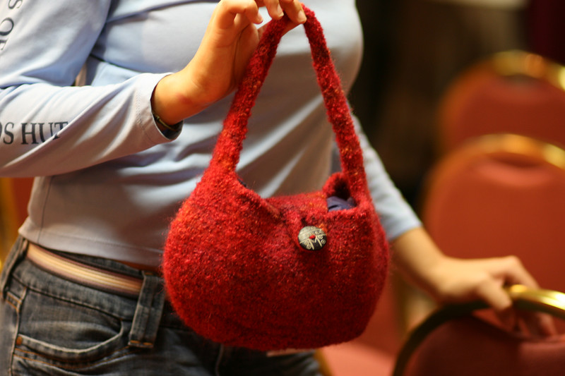 Abby showing off her knitted bag.