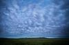 Surreal mammatus clouds near Cochrane, Alberta, Canada.
