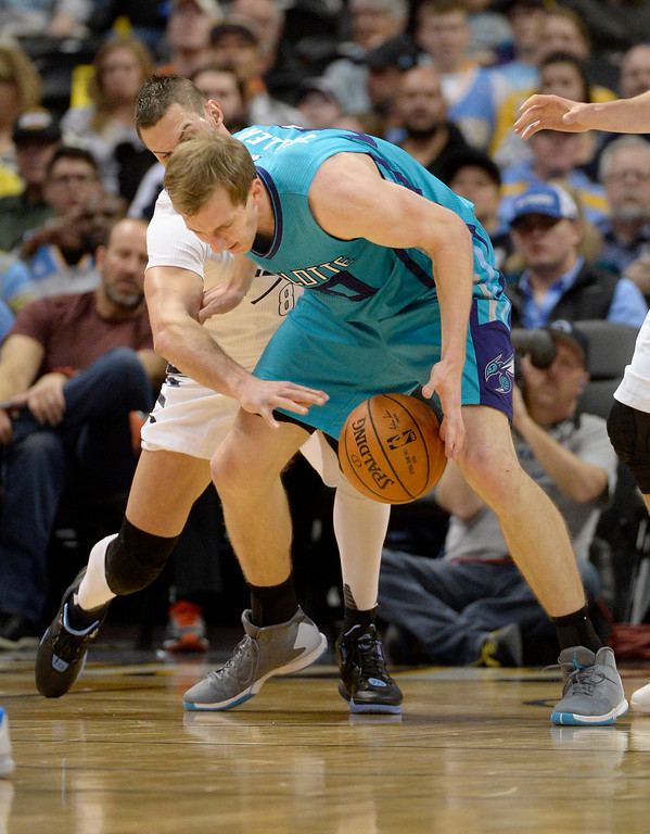 . Danilo Gallinari (8) of the Denver Nuggets strips the ball from Cody Zeller (40) of the Charlotte Hornets during the first quarter. The Denver Nuggets hosted the Charlotte Hornets at the Pepsi Center on Sunday, January 10, 2016. (Photo by AAron Ontiveroz/The Denver Post)