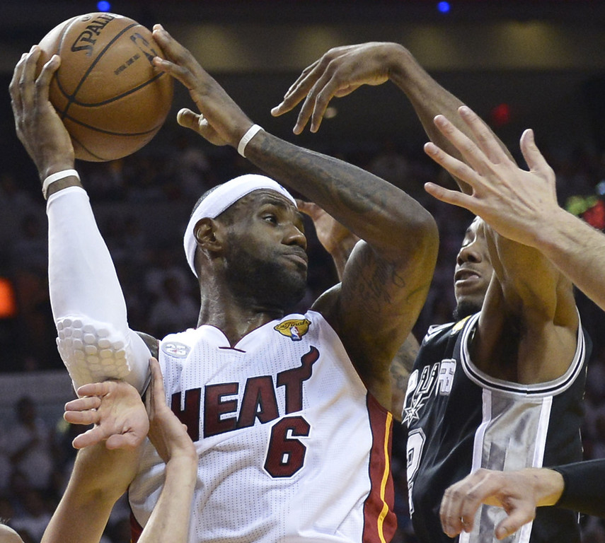 . LeBron James (L) of the Miami Heat is guarded by Kawhi Leonard (R) of the San Antonio Spurs in the first half during Game 7 of the NBA Finals at the American Airlines Arena June 20, 2013 in Miami, Florida.      BRENDAN SMIALOWSKI/AFP/Getty Images